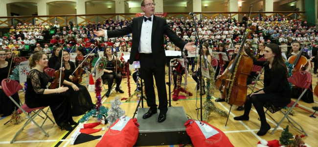 SCHOOL CAROLLERS RAISE THE ROOF FOR MAYOR'S CHARITY